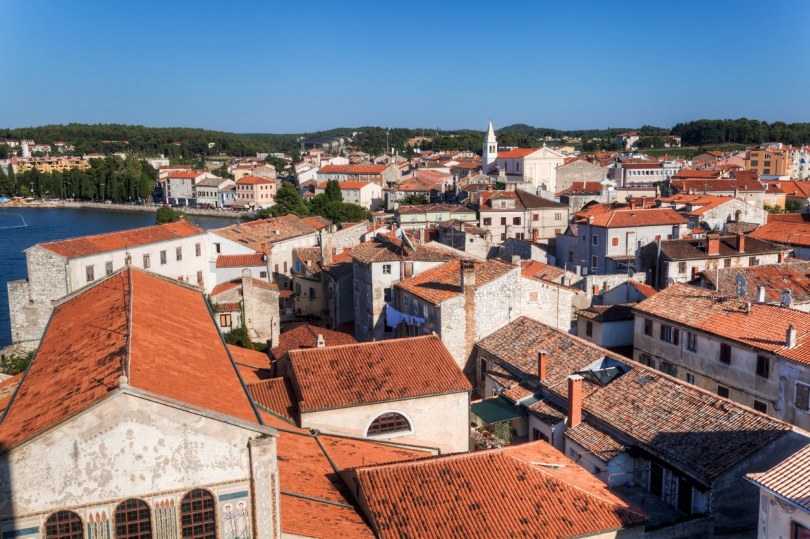 'aerial view over the roofs of the famous Croatian town Porec' - Istria