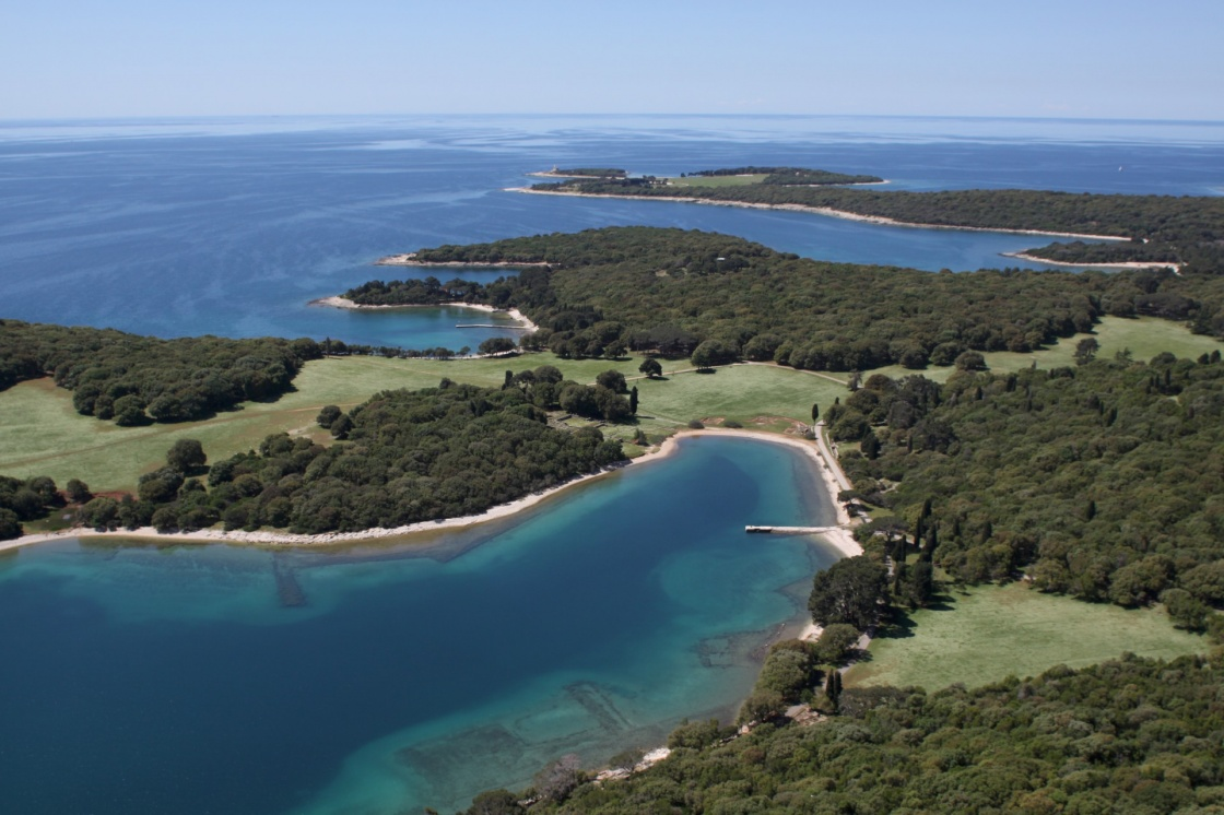 National park Brijuni  are a group of fourteen small islands in the Croatia part of the northern Adriatic Sea , bay Verige with old Roman monuments - aerial view